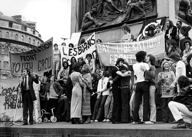 People holding pride banners